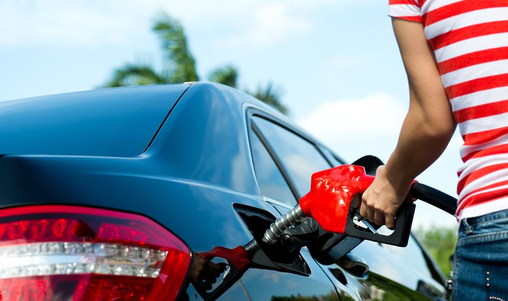 woman filling car with premium or regular fuel